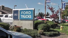 Ford Truck Sign At Dealership Stock Footage