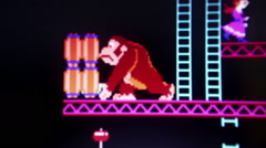 Close up of 'Donkey Kong' with primary gorilla antogonist rolling barrels to Stock Footage