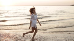 beauty happy smiling woman at sea at sunset slow motion - stock footage