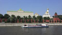 Tourist boat (in 4k) on the Moskva River passing the Kremlin, Moscow, Russia. Stock Footage