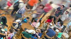 Blurry, abstract shot of diners enjoying a meal in the food court Stock Footage