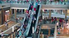 Customers strolling about the many floors of the Shoppes at Marina Bay Sands Stock Footage