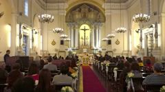 Wedding ceremony inside St. Anthony of Padua Church in downtown Macau - stock footage