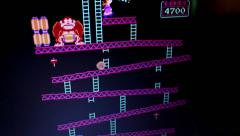 Wide shot 'Donkey Kong' retro arcade vintage videogame during game play from - stock footage
