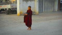 Stock Video Footage of Young, Buddhist monks in their traditional robes, walking down a street