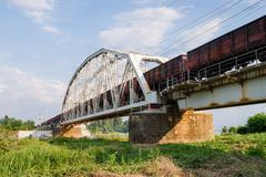 Freight train passes over the bridge Stock Photos