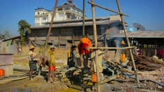 Laborers drilling a well in the small town of Nyaung Shwe, Myanmar Stock Footage