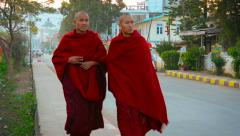 Two Buddhist monks in their traditional robes in Nyaung Shwe, Myanmar - stock footage