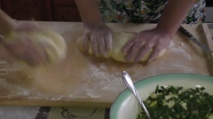 Grandmother with grandson knead the dough Stock Footage