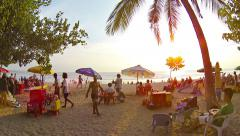 Businesses selling and renting all sorts of goods to tourists in Kuta, Bali - stock footage