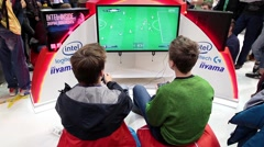 Two kids playing video soccer game Stock Footage