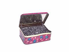 An old tin box full of Shoe nails Stock Photos