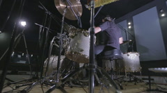 A drummer performing on his Drumset, dolly Stock Footage