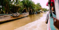 Boat on a canal in Mekong delta, Vietnam Stock Footage