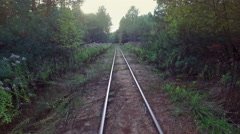 4K. Low flight above narrow-gauge railway in the forest, aerial view. - stock footage