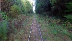 4K. Low flight above narrow-gauge railway in the forest, aerial view. Stock Footage