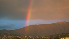 Rainbow in the mountains at sunset Stock Footage
