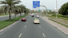 Camera moves over road traffic near Burj Al Arab Hotel Dubai Stock Footage