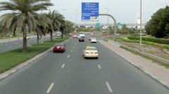 camera moves over road traffic near Burj Al Arab Hotel Dubai - stock footage