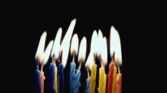 Holiday blow out the candles on the cake - stock footage