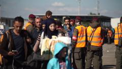 Syrian refugees entering austria Stock Footage