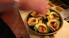 An entree of artichokes is presented ion a bowl. Stock Footage