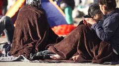 Refugees under blankets - stock footage
