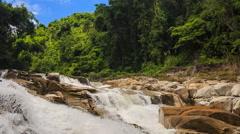 two foamy mountain streams against tropical plants blue sky - stock footage