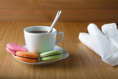 Coffe cup with colorful french macaron Stock Photos