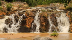 closeup mountain streams falling among stones in park - stock footage