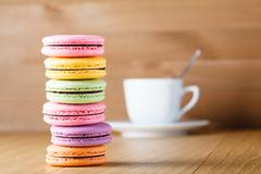 Stock Photo of Six colorfull french macaron and cup