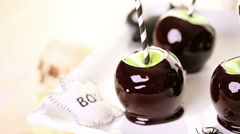 Homemade candy apples for Halloween party on the table. Stock Footage