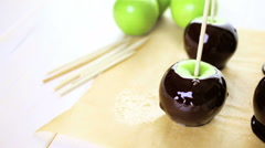 Ingredients for preparing homemade black candy apples. - stock footage