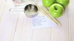 Ingredients for preparing homemade black candy apples. Stock Footage