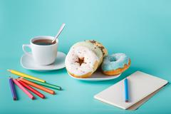 Donuts with sketchbook Stock Photos