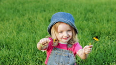 Child on lawn with flower Stock Footage