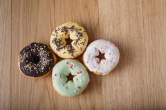 Four donut on table - stock photo