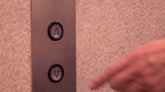 Down arrow on elevator turns blue after being pressed 4k - stock footage