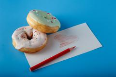 Two donuts and painted heat - stock photo