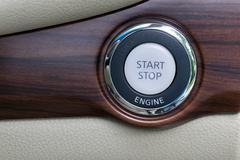 Engine start stop button from a modern car interior Kuvituskuvat