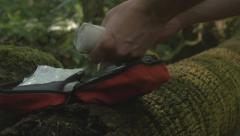 Survival first aid kit with bandage in forest outdoors - stock footage