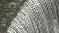Smooth flow of water going over rocks edge 4k Stock Footage