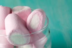 quantity of pink marshmallows in jar - stock photo