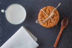 Healthy breakfast. Oat cookies with milk - stock photo