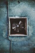 Abandoned air conditioning duct and rusted fan - stock photo