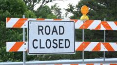 Road closed sign blockading street 4k Stock Footage