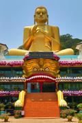 Dambula golden temple in Sri lanka Stock Photos
