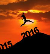 Silhouette happy woman leaps above numbers 2016 - stock photo