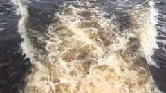 Boat going through water view of dirty trail behind 4k Stock Footage
