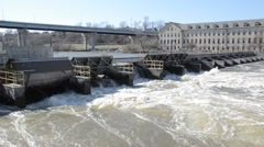 Fast flow of water through barrage Stock Footage